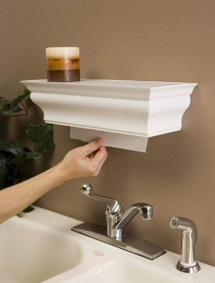 A clever shelf unit with a shelf on top to hide away the paper towels .
