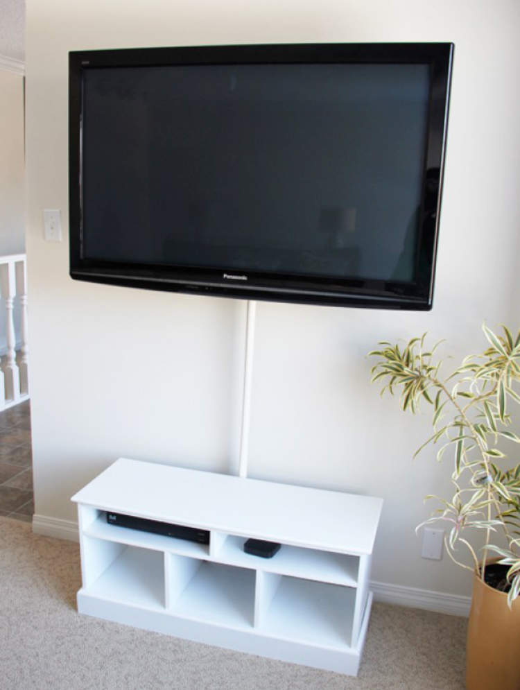 shower rod being used to hide cables from a wall mounted TV