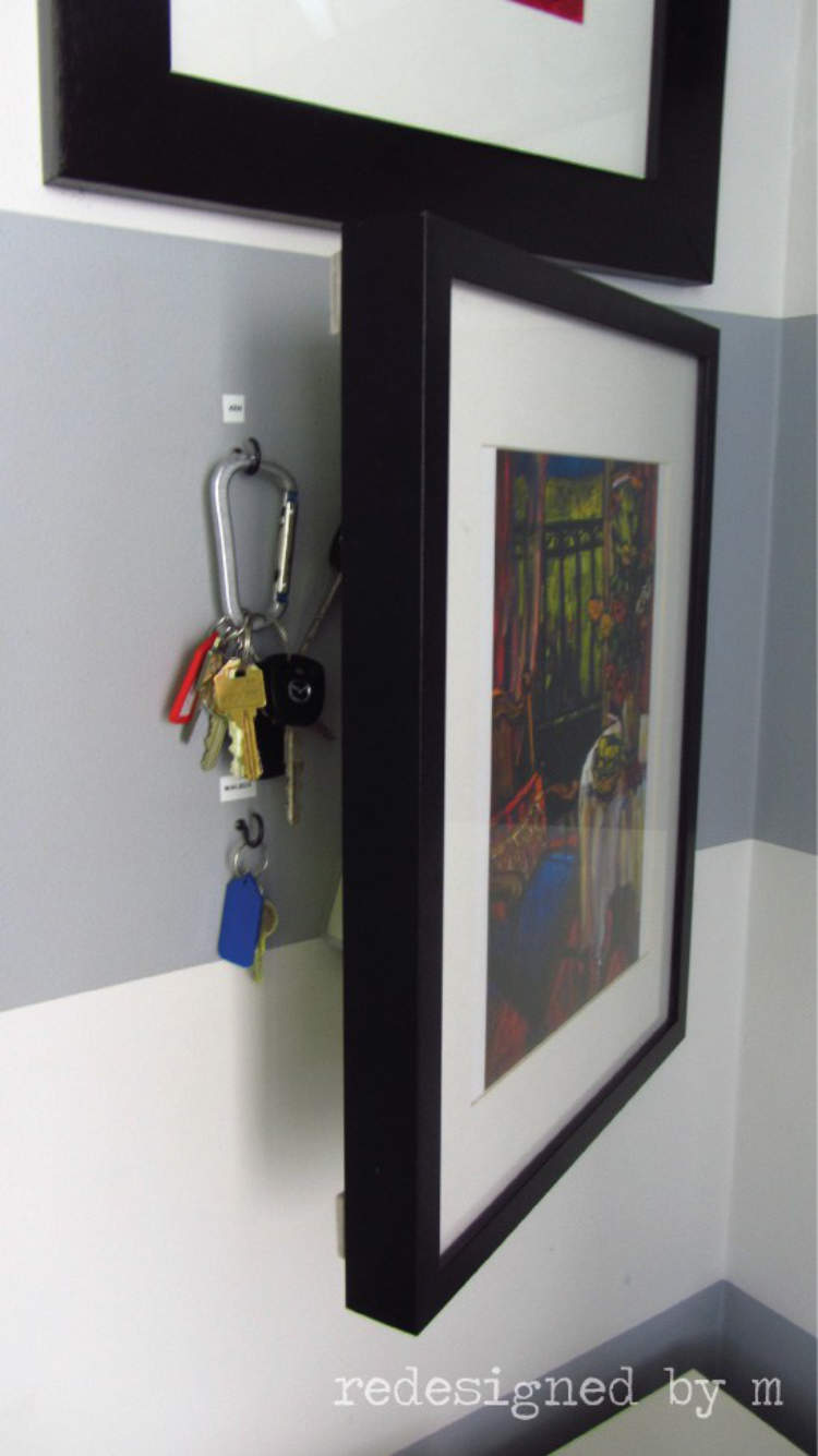Picture frames on a wall adapted to hide away keys and keep them safely out of sight