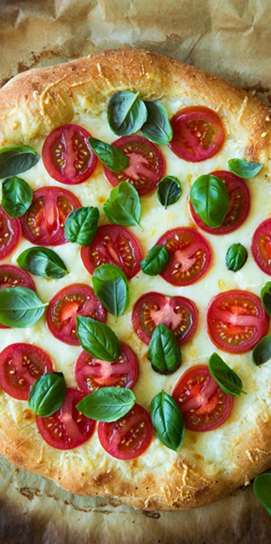 Insalata Caprese Pizza Toppings, tomato, basil and savory mozzarella cheese gourmet pizza.