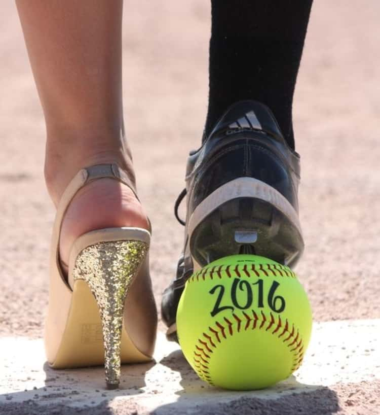 senior picture ideas for girls - girl's feet in high heel and cleat