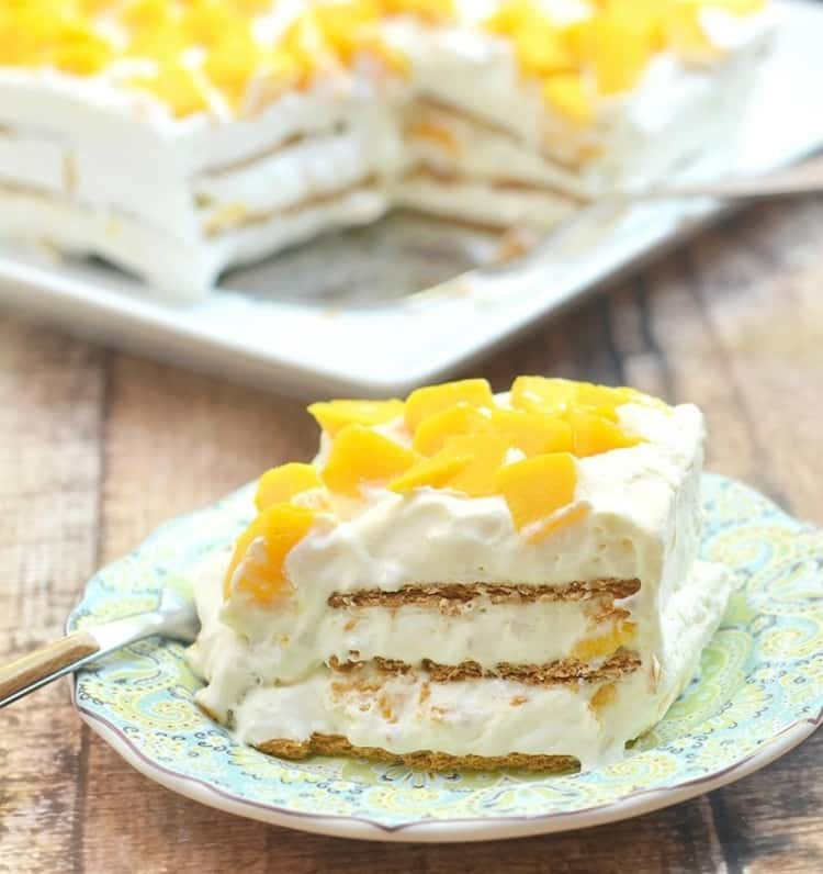 A piece of mango royale icebox cake on a plate