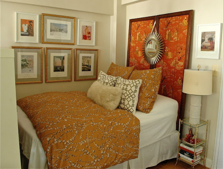 a decorative divider used as a headboard in an apartment