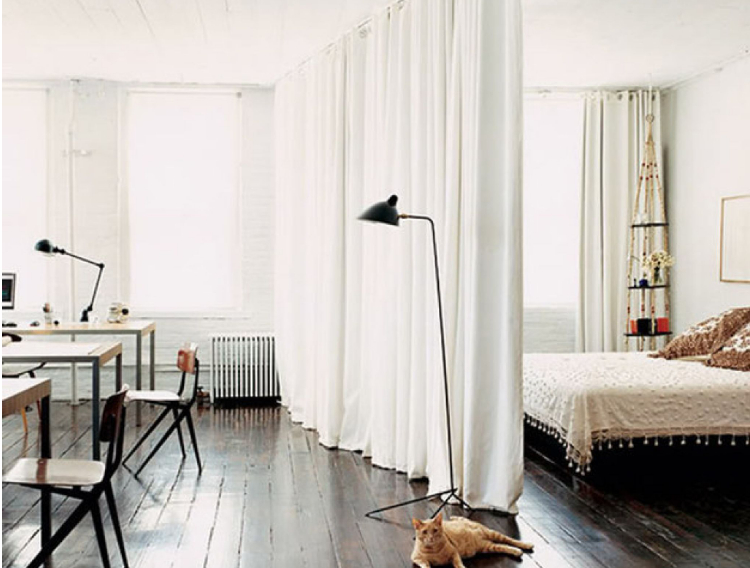 apartment decorating with divider separating bed and living room in studio