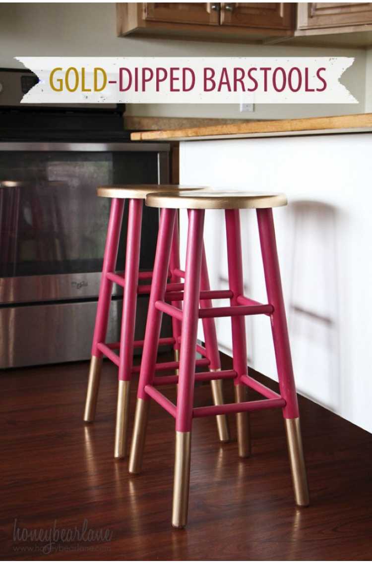 apartment decorating with gold dipped and raspberry colored stool