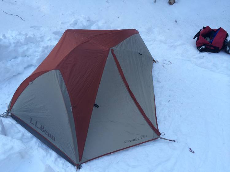 cold-weather-camping image of a tent in the snow