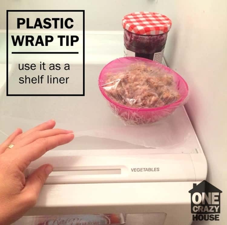 use plastic wrap to line the shelves of your fridge and reduce the number of times you clean it