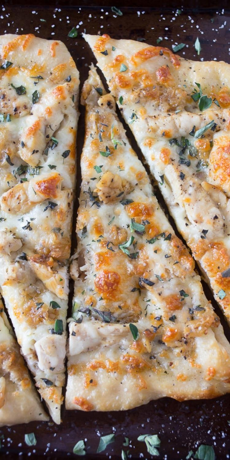 Pizza topped with caramelized garlic and roasted chicken. Easy gourmet pizza.