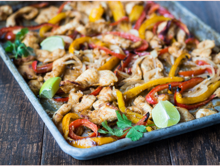 Sheet-pan-fajitas: red and yellow bell peppers, green herms, lime, and chopped chicken