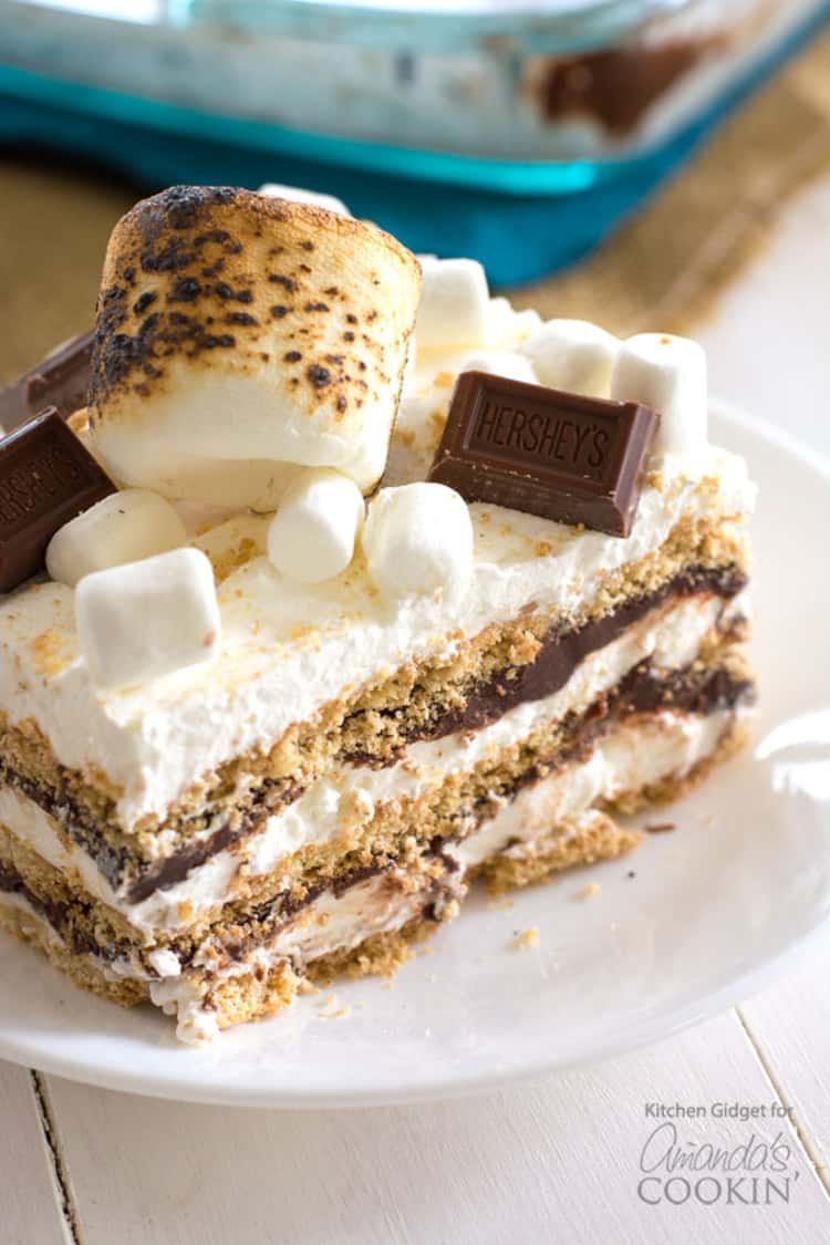 Smores icebox cake topped with smores, marshmallows and a piece of chocolate