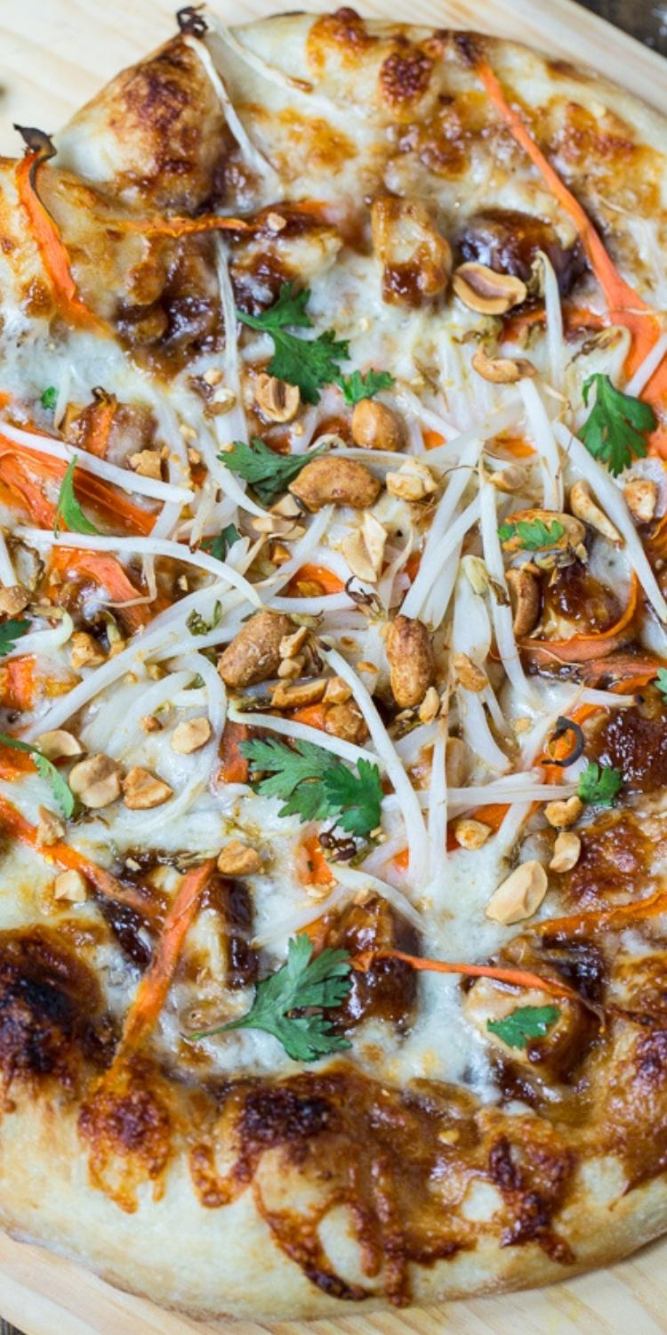 Sweet & Spicy Pad Thai Pizza topping recipe on yummy flatbread pizza. Peanuts, carrots, and chicken on cheese with pad thai sauce on medium thick crest.
