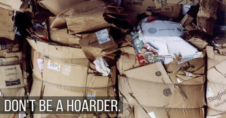 """50 Things You Need to Throw Away - compacted cardboard boxes - image of several piles of compacted cardboard boxes to be recycled and the words """"Don't Be a Hoarder"""""""