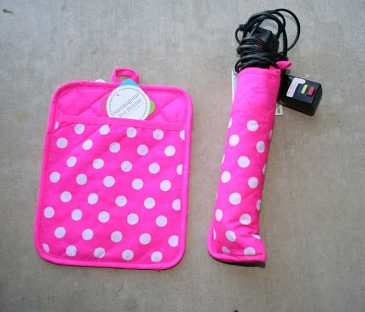 Using heat safe pot holder to hold curling iron or flat iron