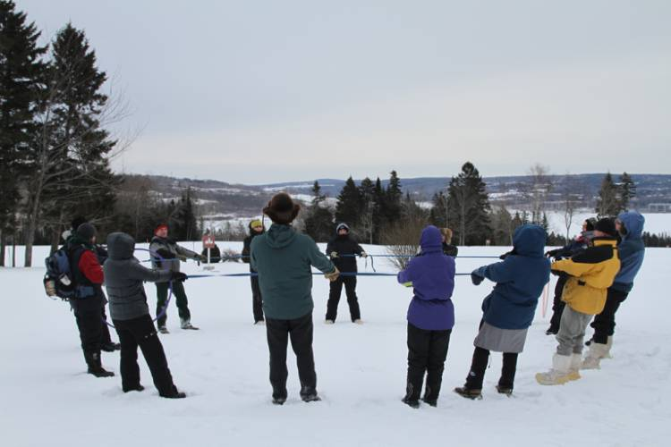 cold-weather-camping image of campers in the snow playing team-builder games