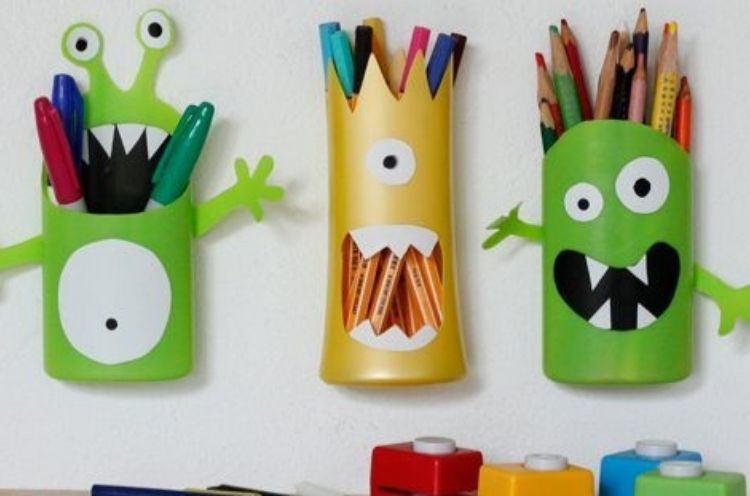Fun and creative way to reuse your shampoo bottles as monster themed pencil holders by cutting off the tops and adding eyeballs and teeth.