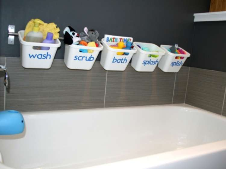 bath tub with buckets hanging from wall