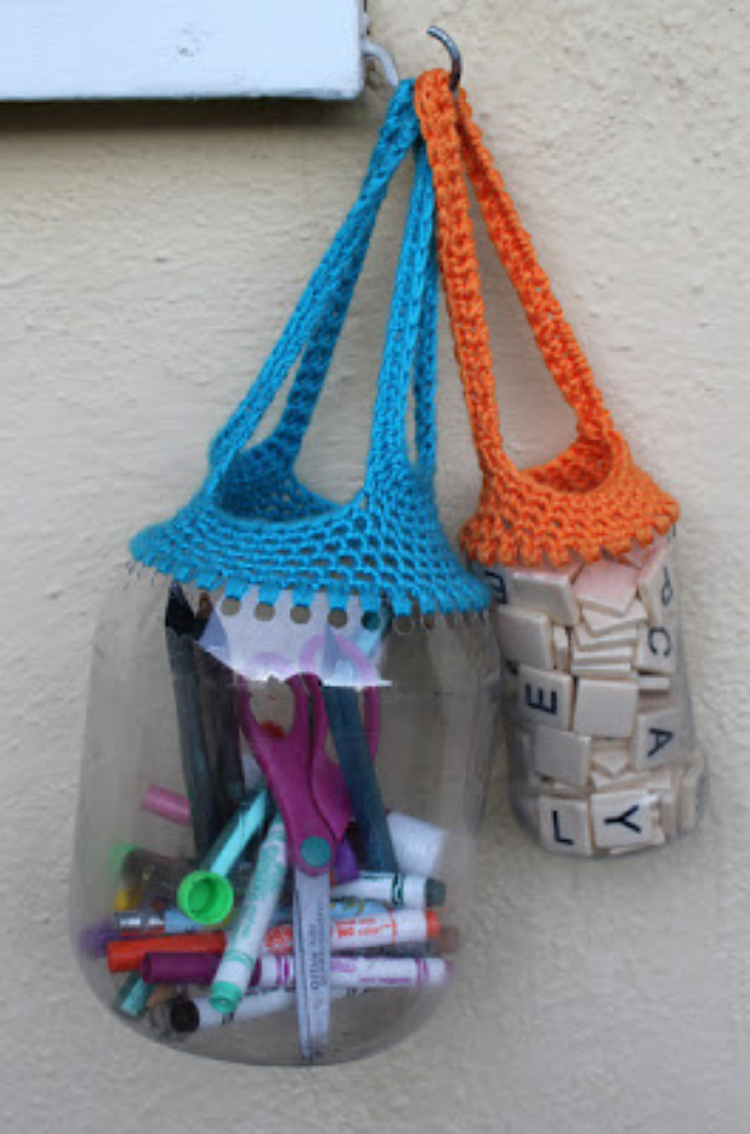 Different size bottles used as necklaces or bags after punching wholes around the open top and crocheting straps around them.