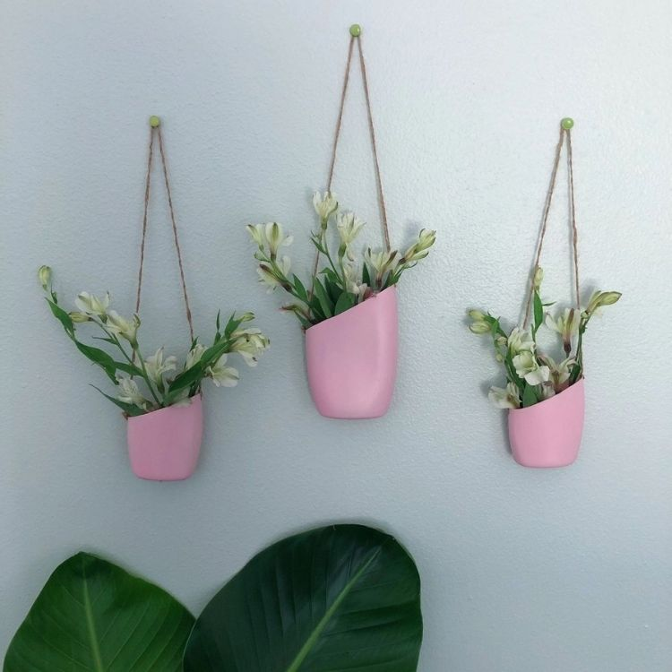 Cut the top of your old plastic bottle off at an angle and add some string to hang for a great place to put your house plants.