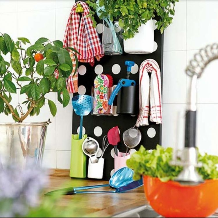 Use old lotion and shampoo bottles to create a storage or tool rack to keep all your odd little gadgets.