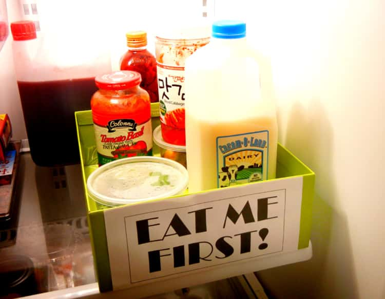 organize your fridge with a triage box for food that needs to be consumed as soon as possible