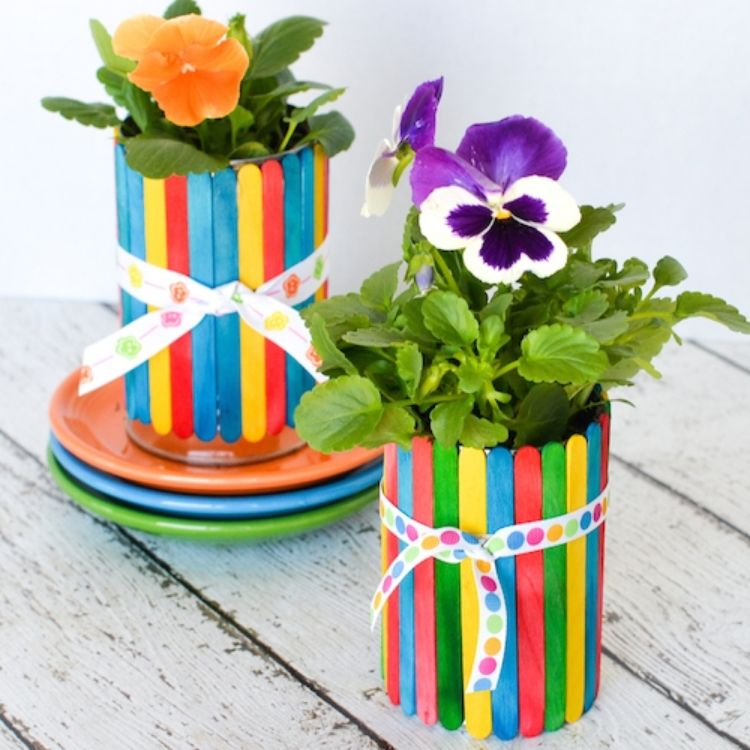 Coloured crafts sticks on tin can for flower pot