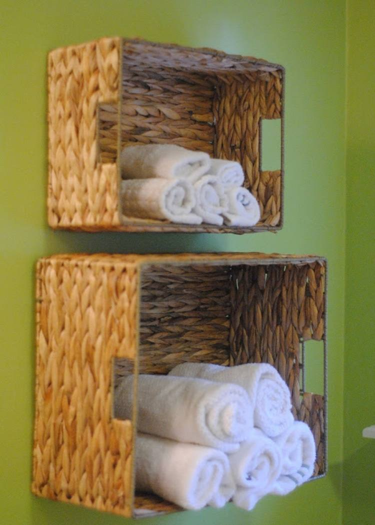 Woven baskets on the wall hold white rolled towels to keep things tidy and clean.