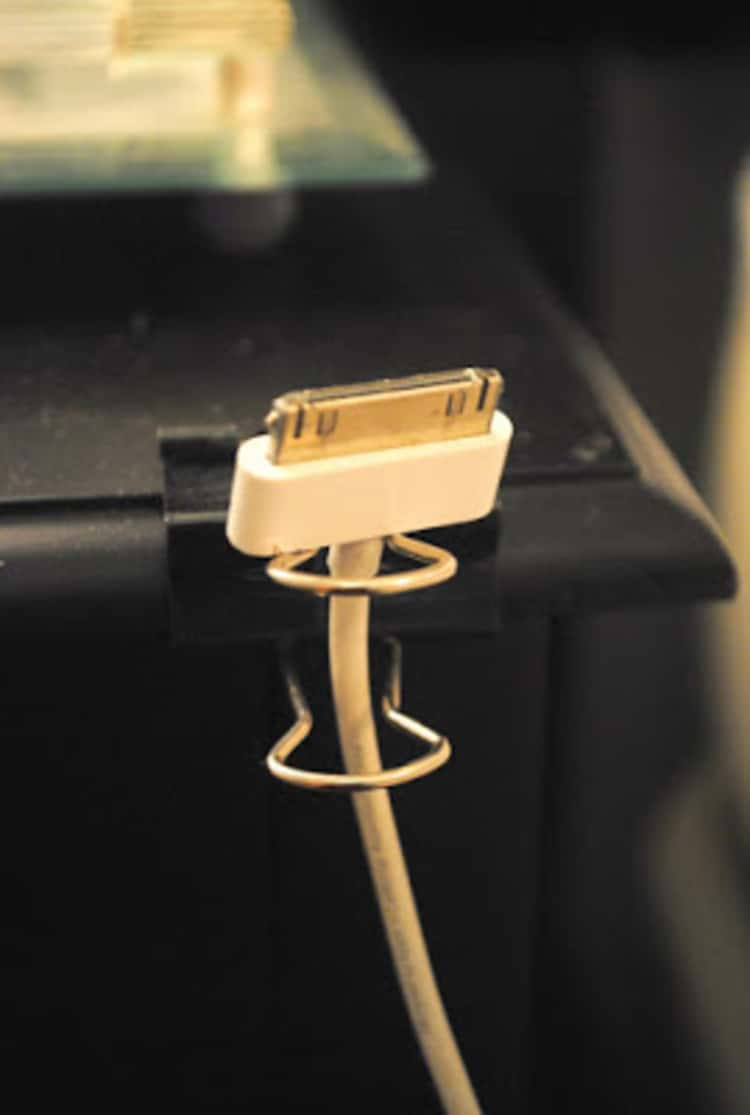 Using a file binder clip to hold a charging cord
