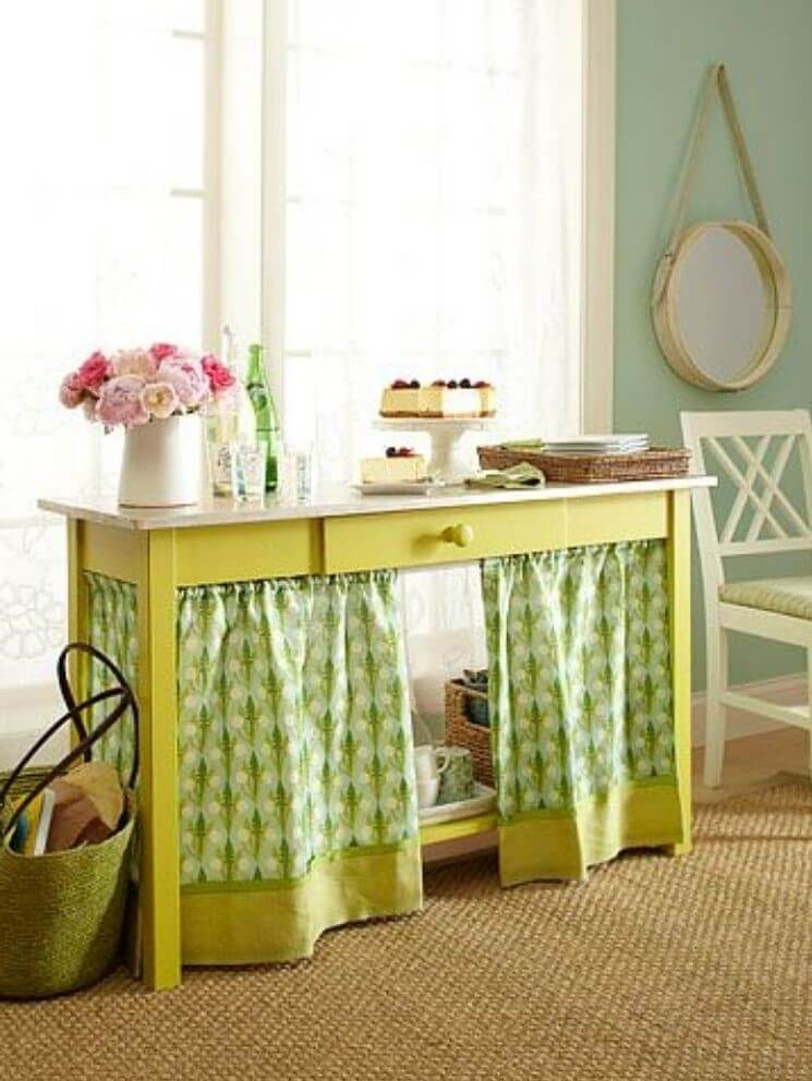 Manage your cables by hiding them behind a fabric curtain attached to the underside of a table or desk
