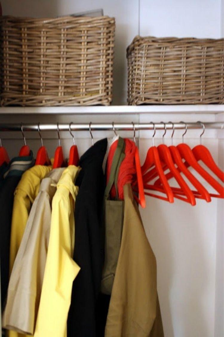 Coat Closet Organization Ideas - Spray paint your coat hangers to make them colorful