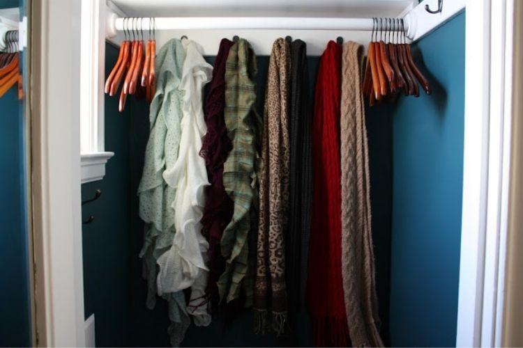 Coat Closet Organization Ideas - Use large hooks to organize scarves