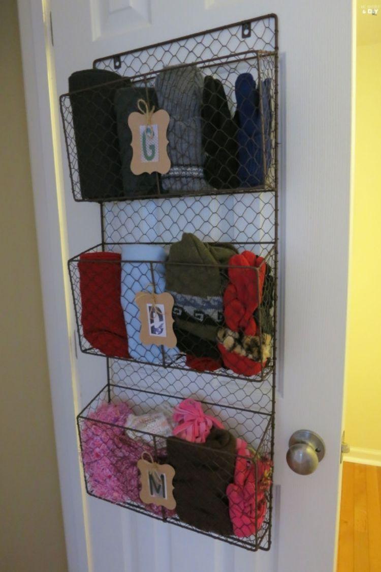 Coat Closet Organization Ideas - Hang magazine baskets to organize small items like children's winter wear