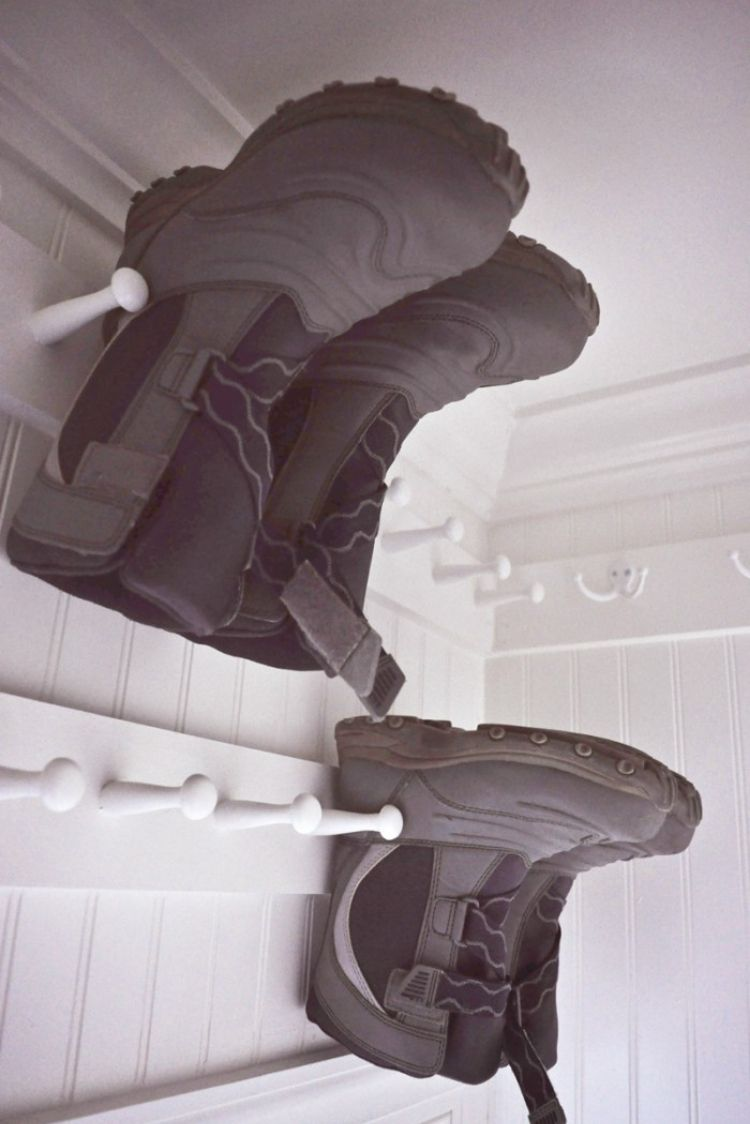 Coat Closet Organization Ideas - Install shoe pegs inside the coat closet