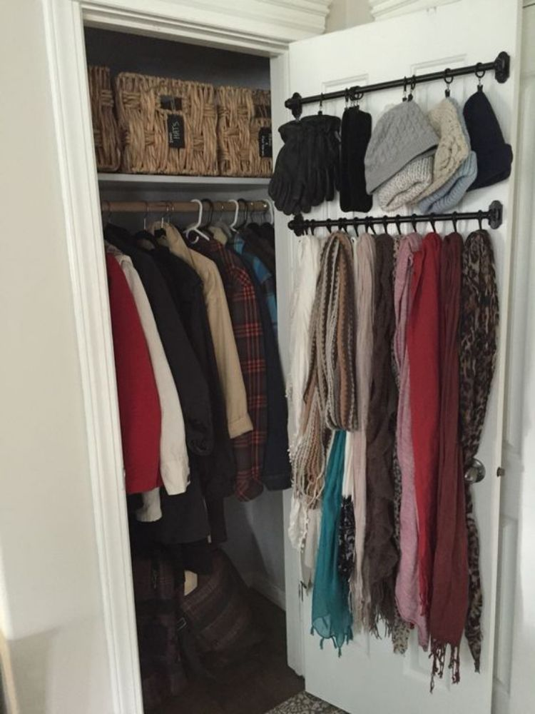 Coat Closet Organization Ideas - Add towel racks and shower curtain rods to organize scarves and winter wear