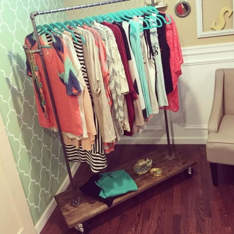 DIY clothing rack filled with clothes and accessories