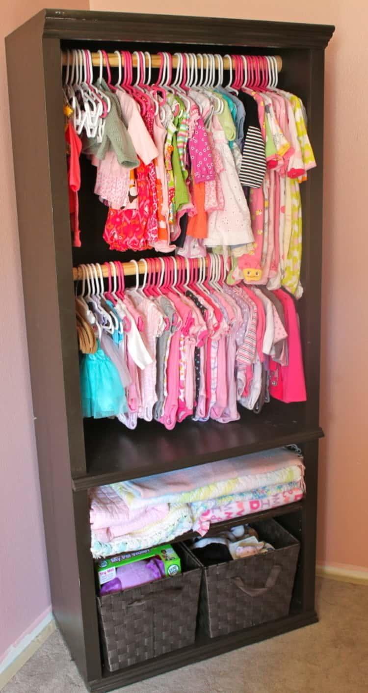 Install closet rods into a bookshelf to store kids clothes