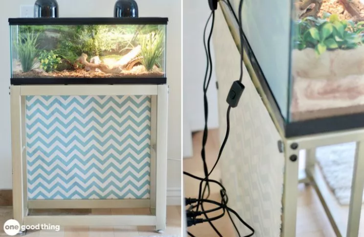 a snake terrarium with fabric attached to the metal stand using magnets for cable management