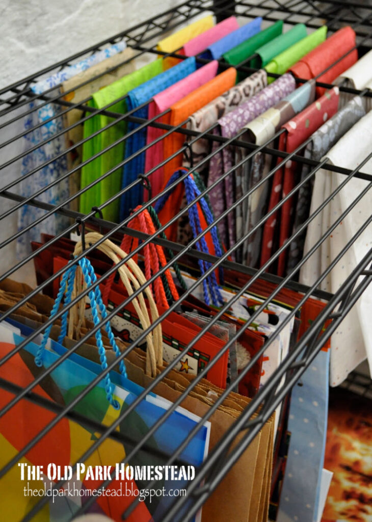 Gift wrap hanging from wire rack - The Old Park Homestead Blog