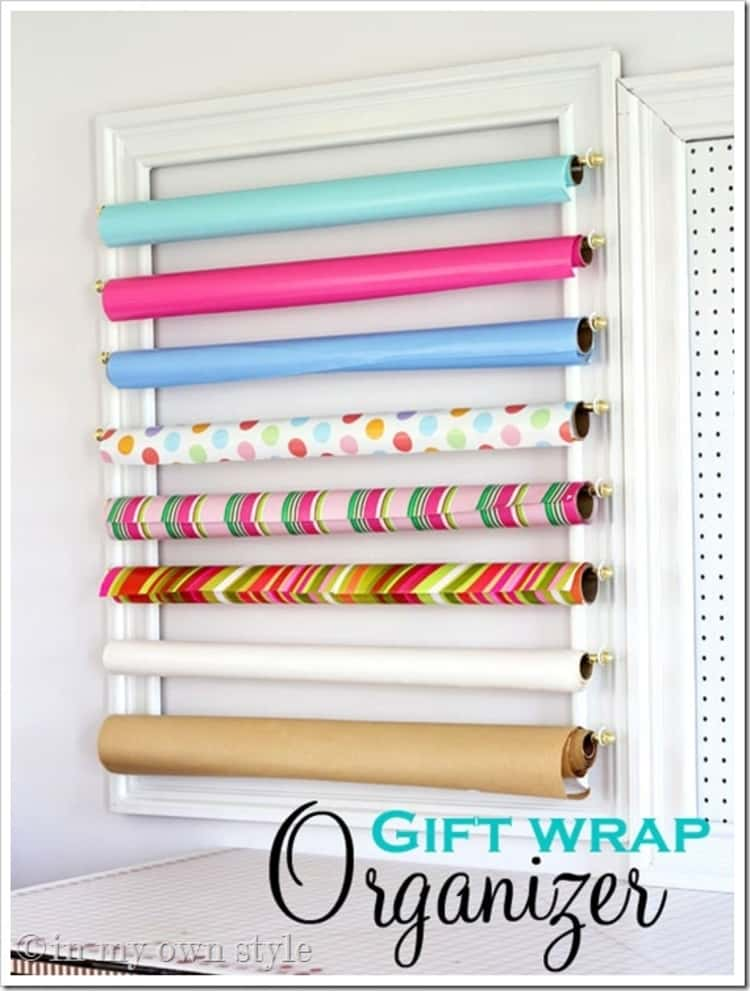 Gift wrap organizer hanging gift wrap rolls on a wall stacked one on top of another horizontally