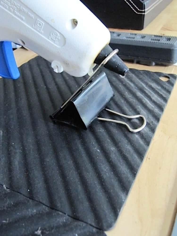 Hot glue gun held up using a file binder clip