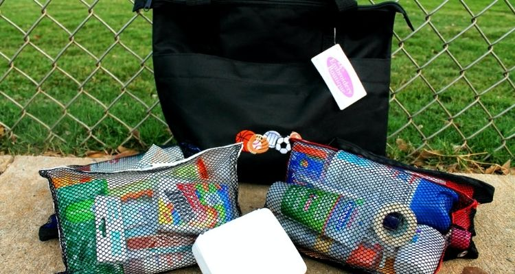 First aid supplies in a pouch for sports moms
