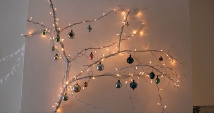 Dry lighted branches on wall