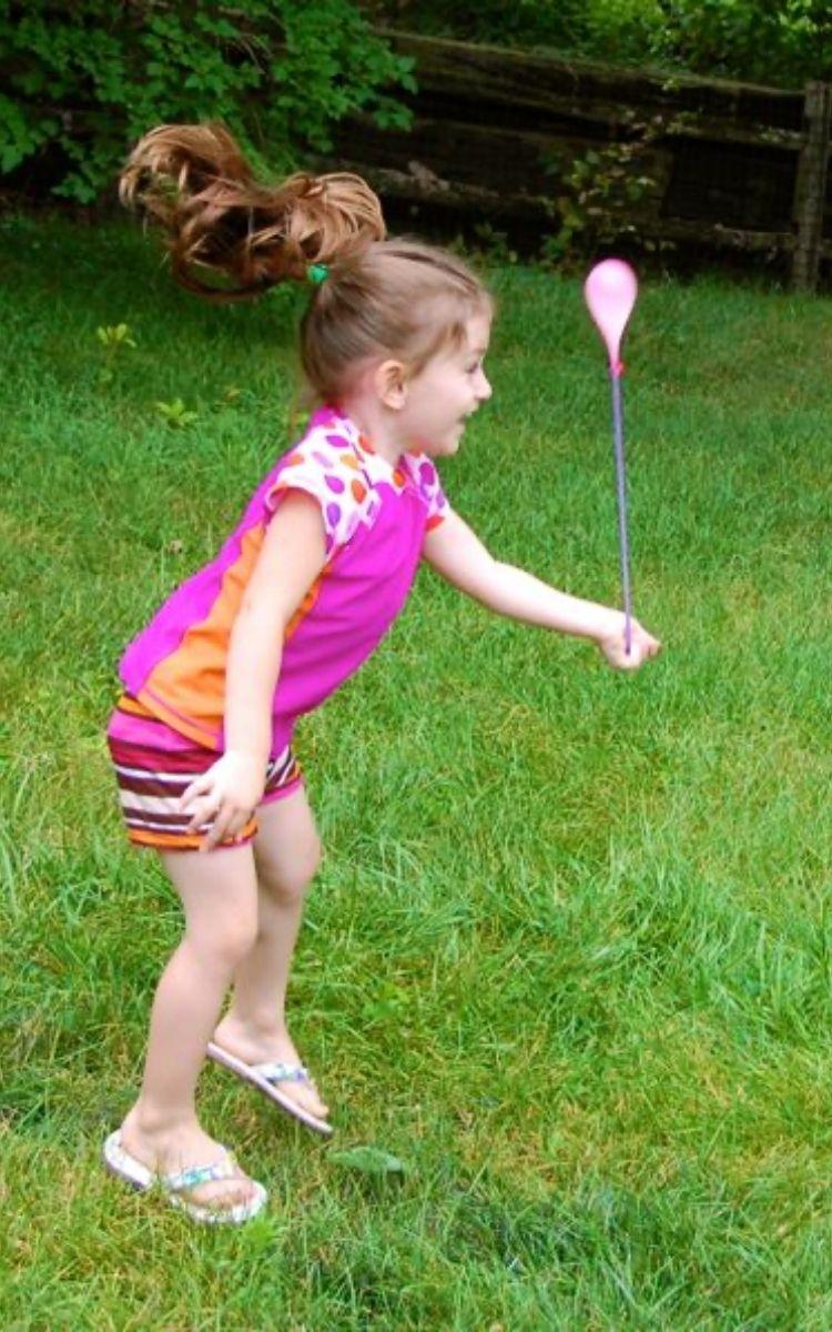 Girl playing with Yo yo water balloons