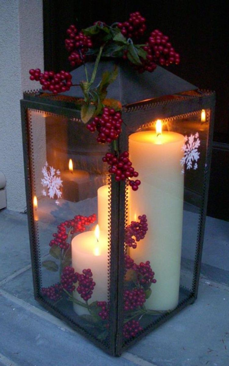Christmas porch lantern with lit candles inside