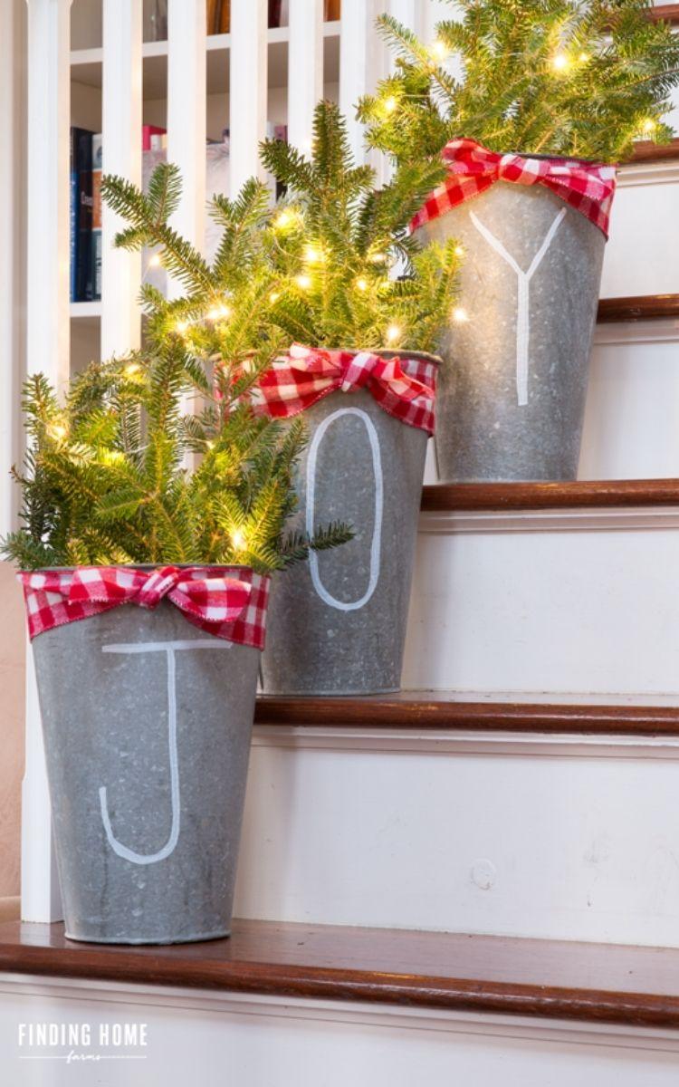 Galvanized Joy buckets with lights and greenery