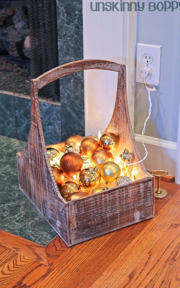 Lighted basket of ornaments