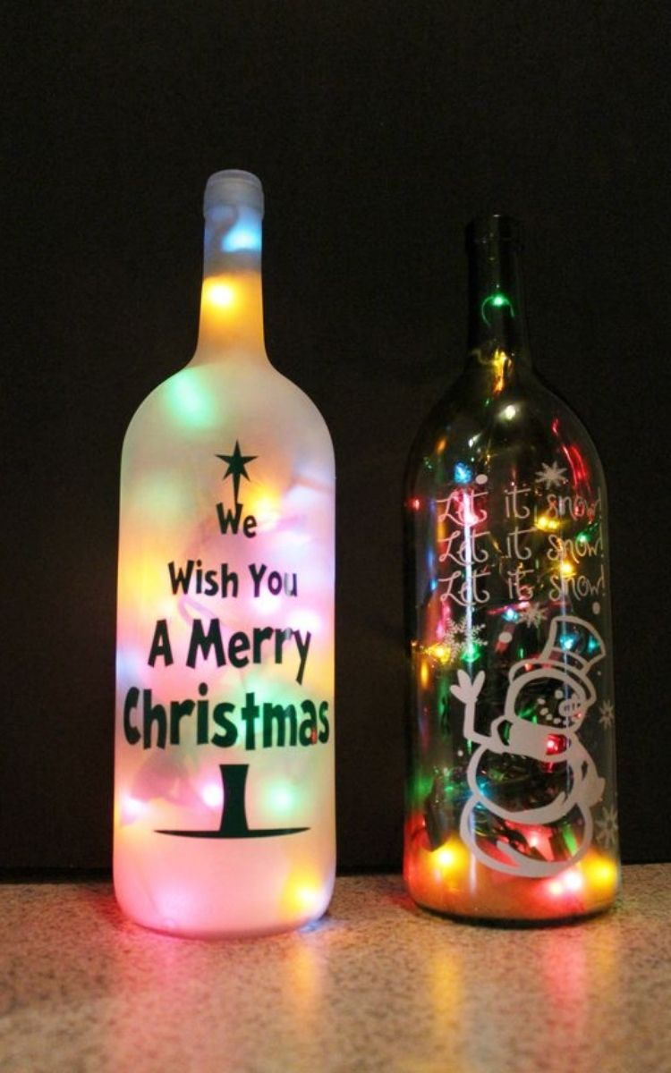 lighted wine bottles with painted Merry Christmas