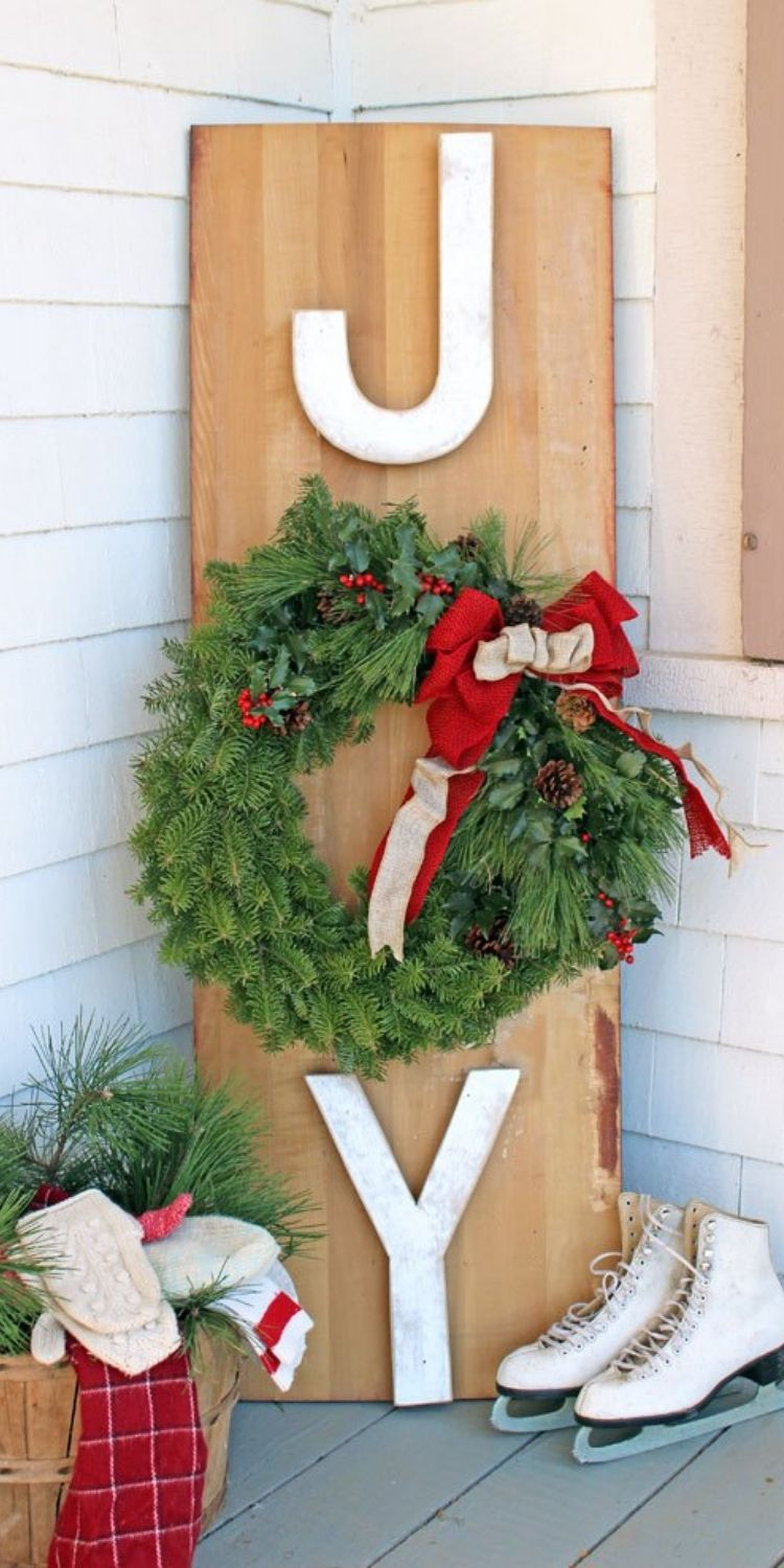 Joy porch sign with wreath and sakes