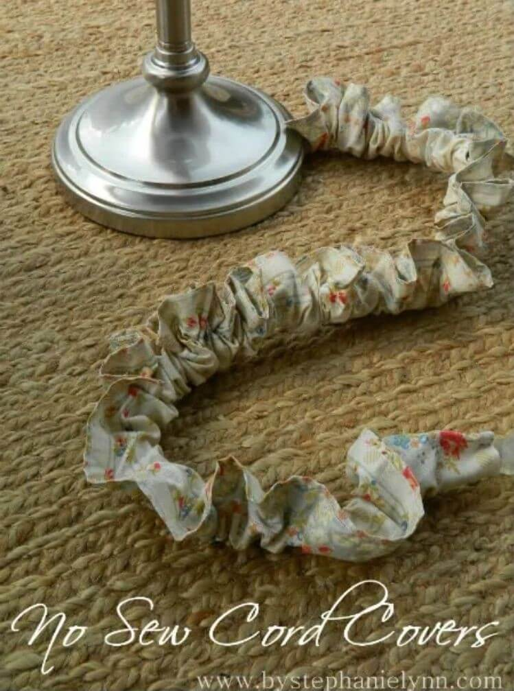 A lamp cord wrapped in ruffled fabric to hide the cable