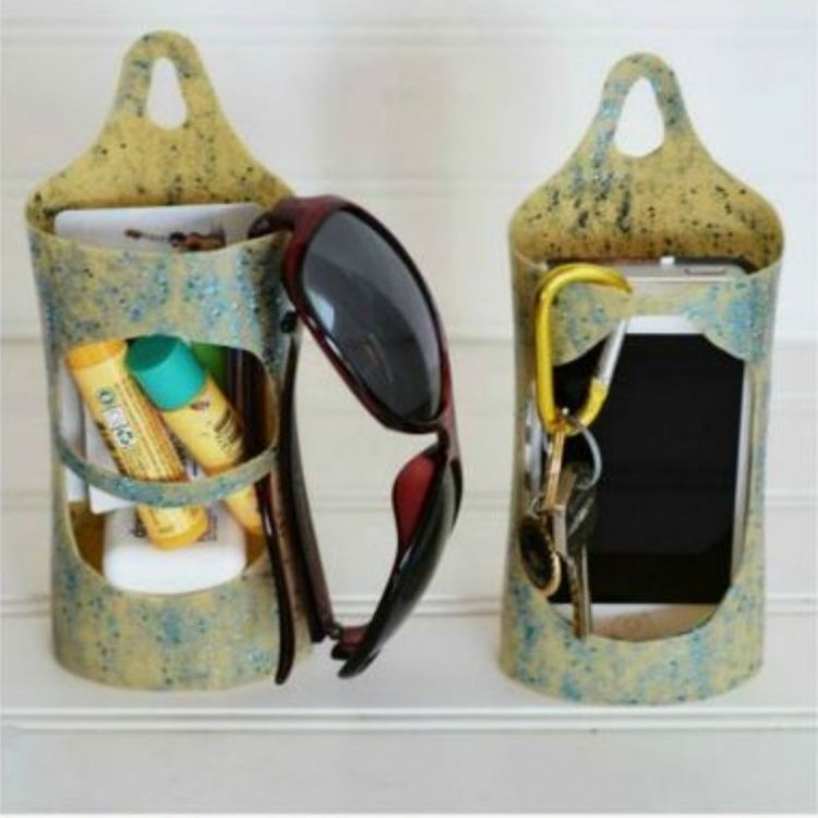 Clever little caddy container for all sized items reused out of cut up lotion and shampoo bottles to hold keys and such.