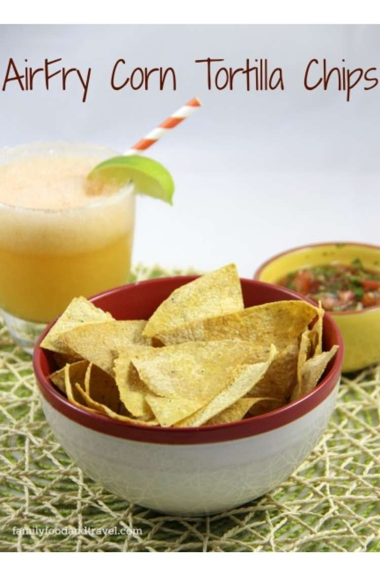 OneCrazyHouse Air Fryer Recipes bowl of homemade corntortillas with a bowl of salsa and a margarita with a lime and straw in the background